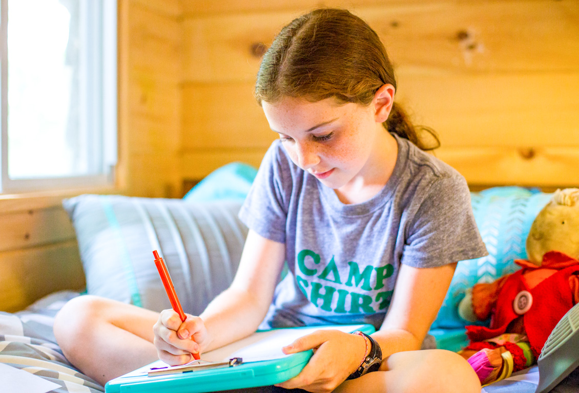 Camper writes letter home from bunk