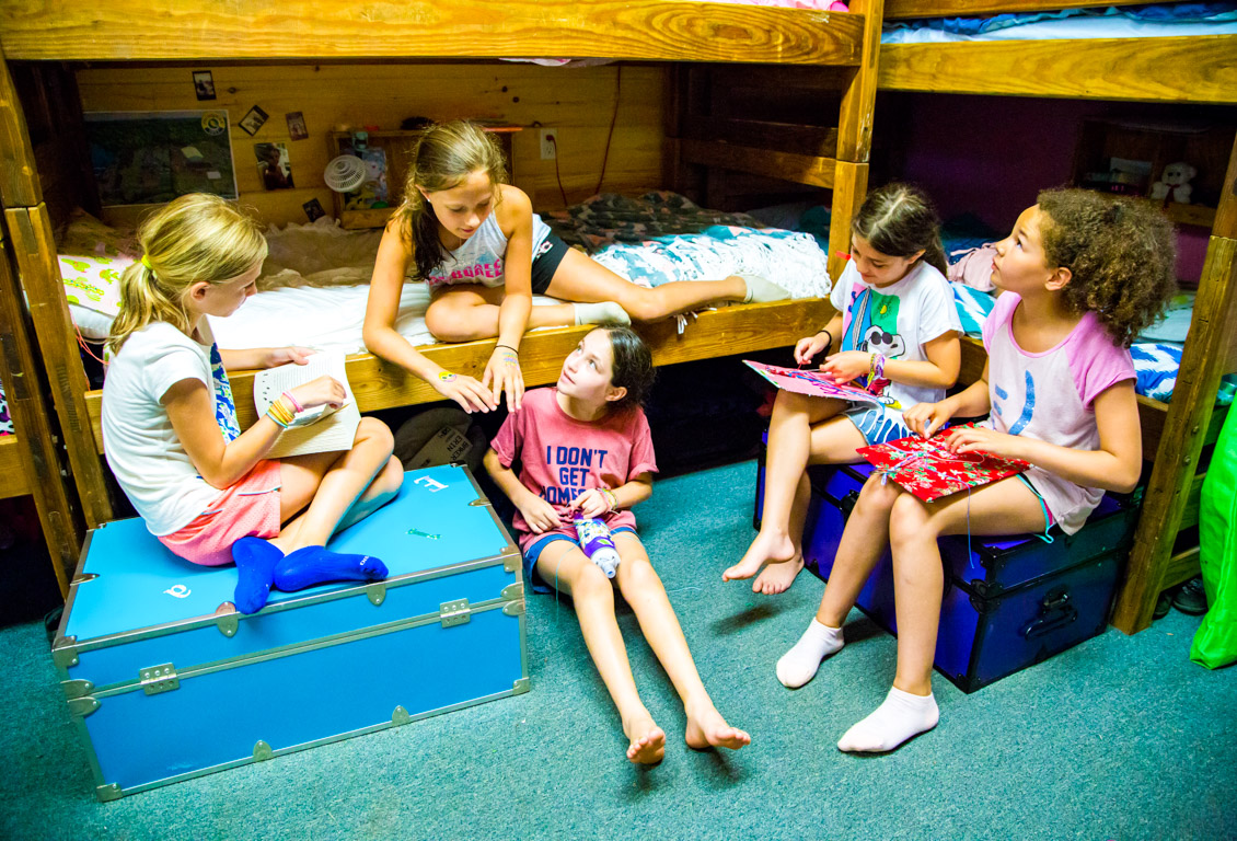 Girls hang out in cabin at summer camp