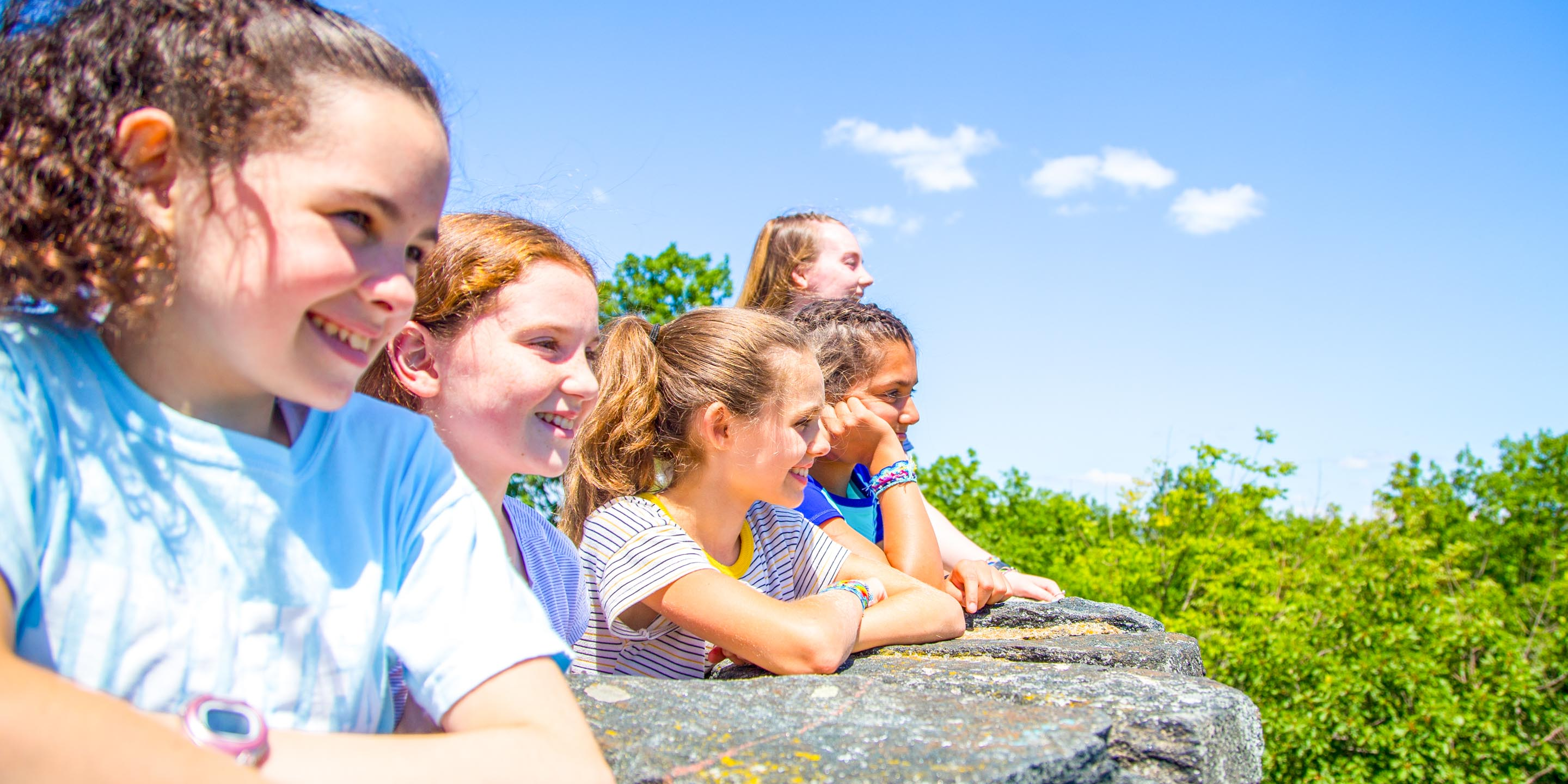 Smiling campers appreciate view from top of hike