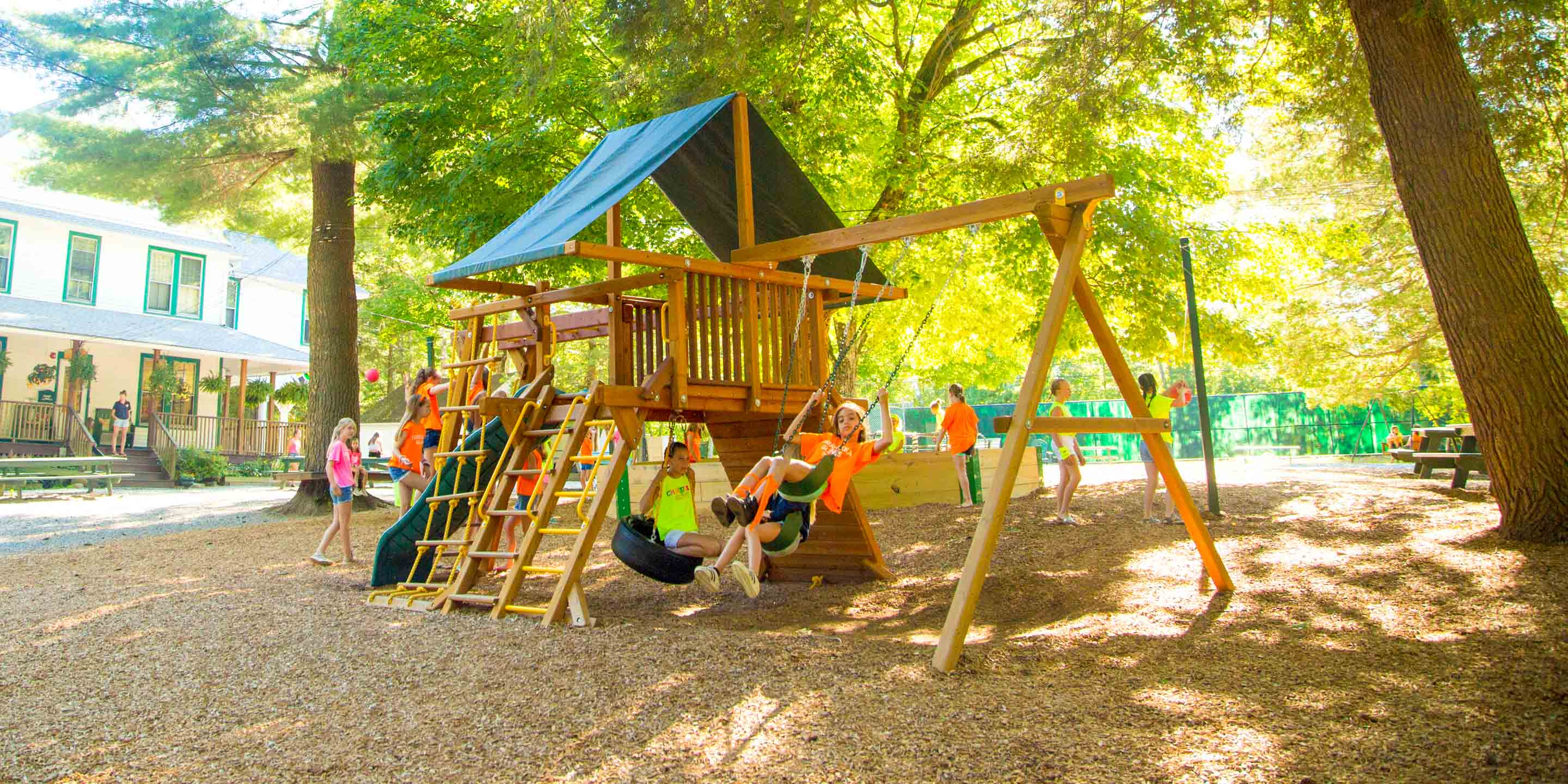 Campers play on playground