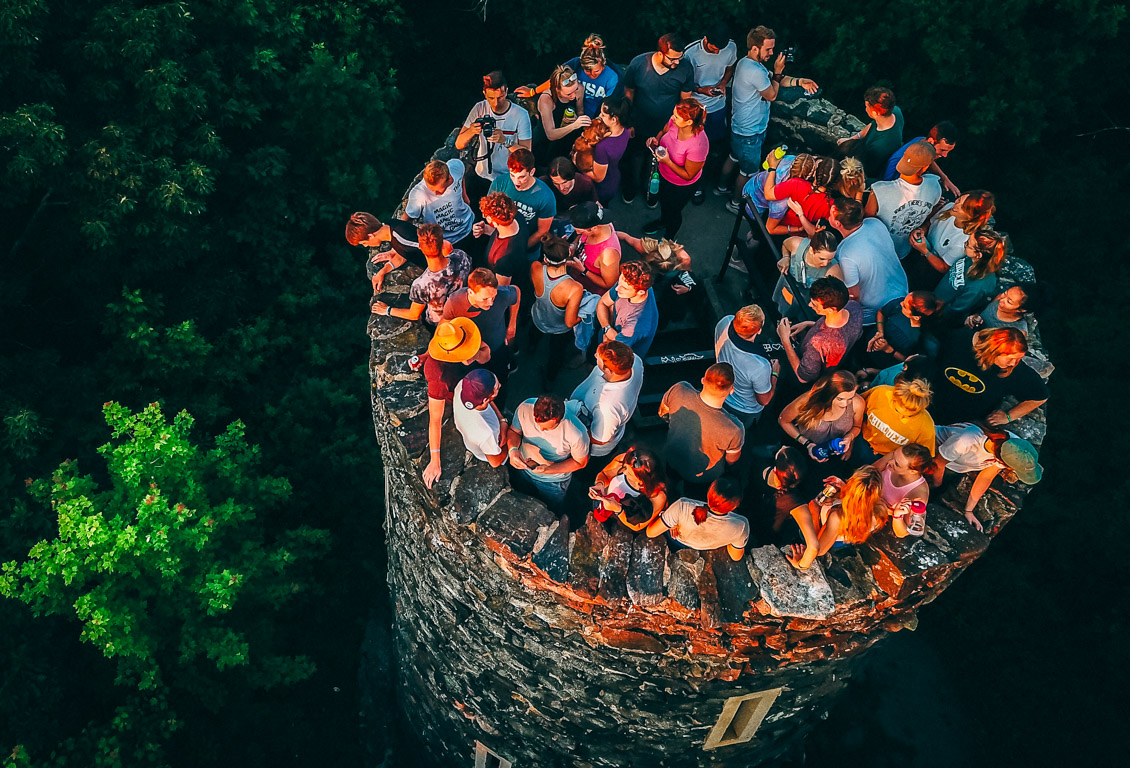 Aerial view of staff members standing on top of tower